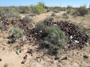 A huge pile of burnt tin cans sits and waits