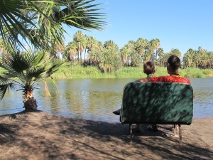 Sitting on a bus seat by the lagoon