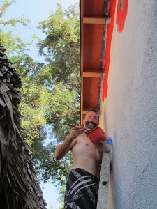 Brendo painting one of the casitas