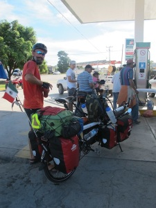 Stopping to fill our camping stove with fuel, we pulled Falkor#2 up to the bowser behind the motor bikes. We created quite a rucas!