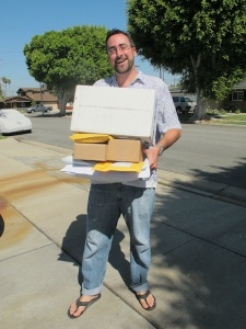 Paul with 12 parcels that we had sent to his address in Huntington Beach, California
