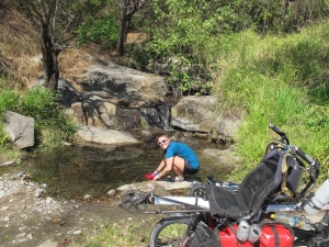 Finding a clear stream by the side of the road s a real treat. we stopped to wet our hats and tops for some air con riding