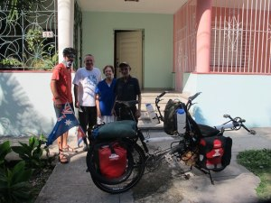 On the right, Margarita & Felo our hosts in Havana. Their neighbour on the left bidding us 'bien viaje' as we  set off on our ride.