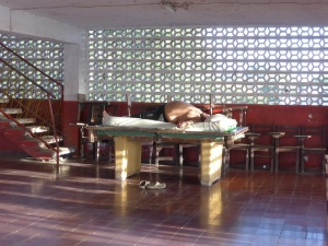 An infamous shot for touring cyclists, the big guy asleep on the pool table