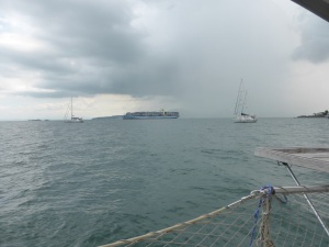 Huge container ships travel pass our mooring and make us feel very tiny on a 44' yacht