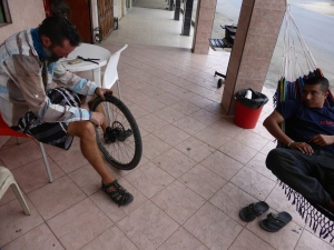 We finish our last day riding in Ecuador and no joke, as we roll into town we get a puncture