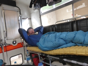 Sleeping on gurneys in a 1973 ambulance. It was cozy and dry...much more so than our soggy tent!